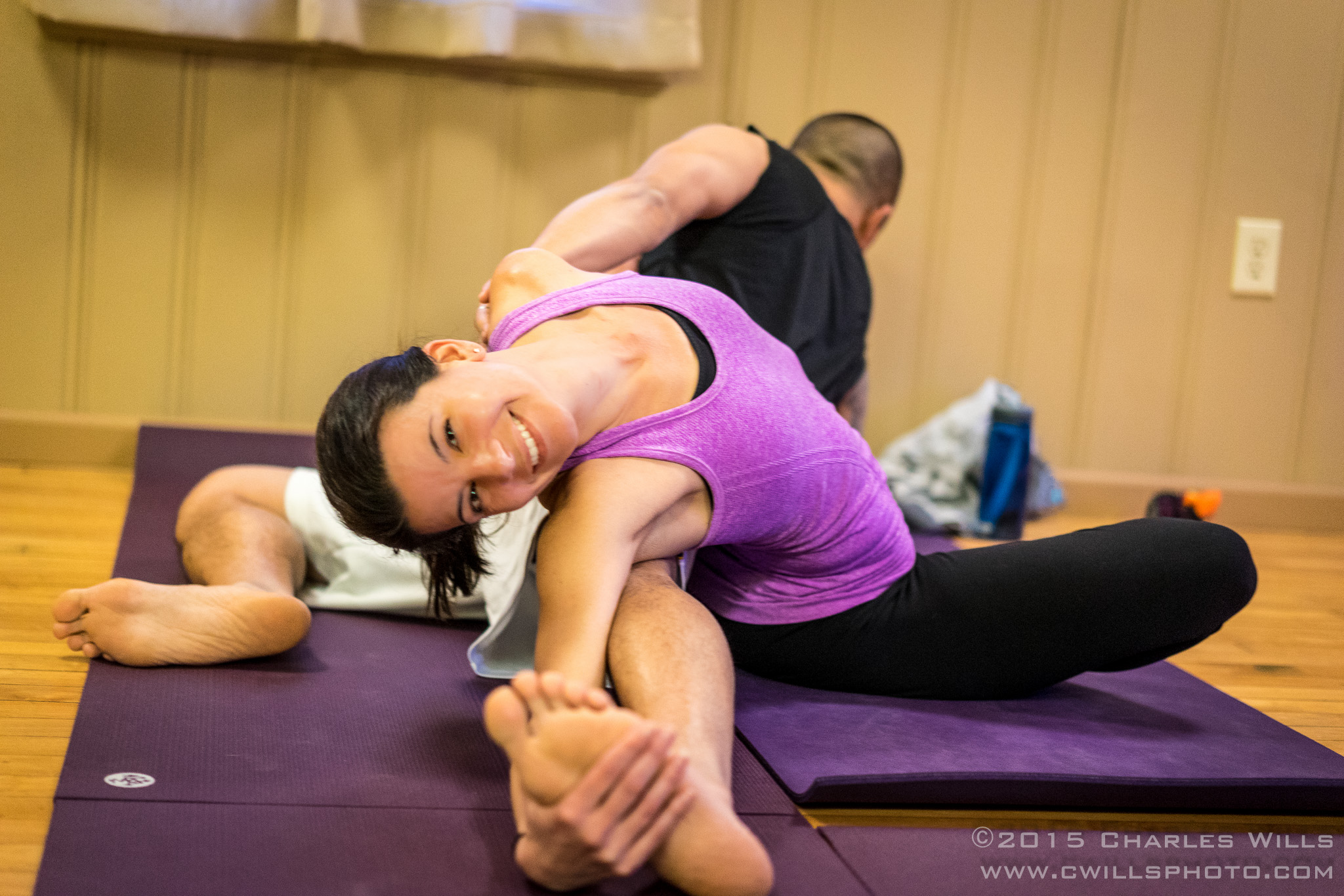 Seated wide legged stretch and twist with partner