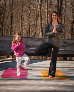 Tree pose with mother and daughter